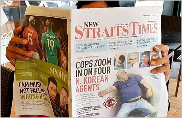 지난해 2월 한 말레이시아 시민이 일간 뉴스트레이츠타임스 1면에 실린 김정남의 피살 직후 모습이 담긴 신문을 읽고 있다. ⓒ연합뉴스