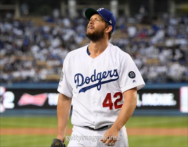 커쇼가 마차도에게 또 대형홈런을 내줬지만 시즌 3승에는 성공했다. ⓒ 게티이미지