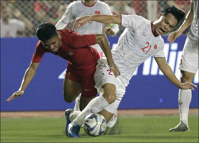 인도네시아 선수들은 베트남을 향해 거칠게 대응했다. ⓒ 뉴시스