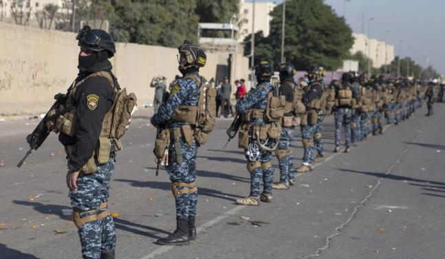 미국 대사관 지키는 이라크 보안군.ⓒ연합뉴스