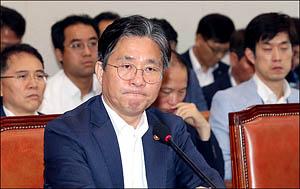 일본과 전쟁에 임하는 성윤모 장관의 결연한 표정